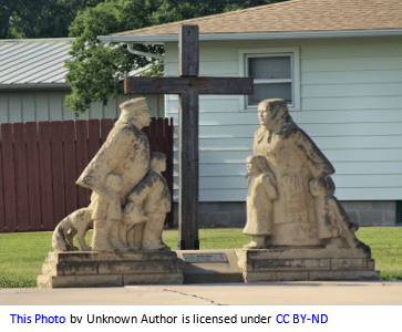 German genealogy by popular US online genealogists, Price Genealogy: image of a stone sculpture consisting of german immigrants standing in front of a cross.
