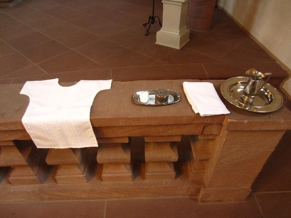 German Genealogy by popular US online genealogists, Price Genealogy: image of a infant blessing gown and silver water pitcher on a silver tray, and a white towel.